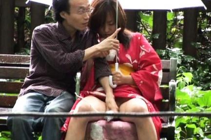 Asian babe in kimono enjoys the outdoors
