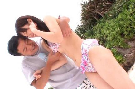 Rina Ooshima gets fucked and a facial on a public beach