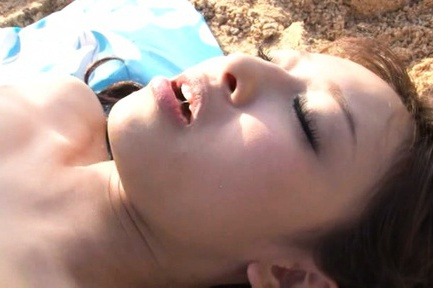 Kinky Japanese milf is fingered and fucked on a beach