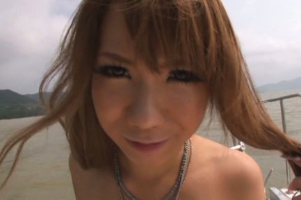 Long-haired redhead Asuka Hoshi engulfs pecker on a boat