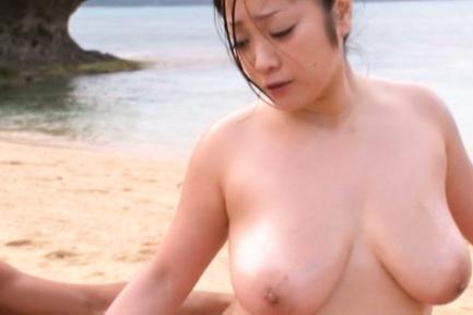 Attractive beach queen Minako Komukai has threesome sex outdoors