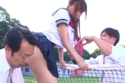 Petite schoolgirl Haruna Aisaka fucked by two dudes on the grass