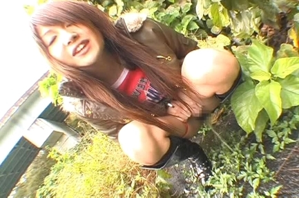 Erika Satoh Lovely Asian doll gives a blow job outdoors