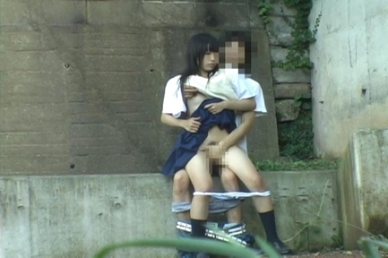 Asian sweetie and her guy having sex on the steps outside
