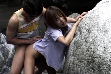 Horny Asian milf starts having sex in nature